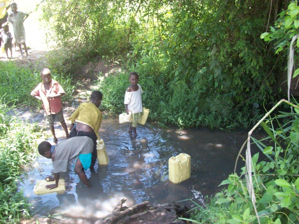Children collecting water from an unsafe source